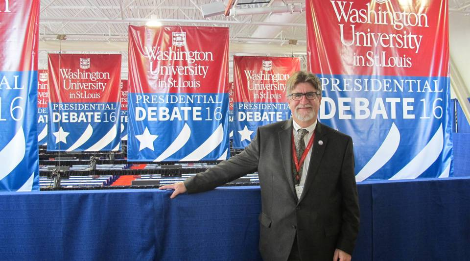"""Steve Givens, chair of the presidential debate steering committee at Washington University in St. Louis. """"We do hang a lot of banners; we don't want anyone to forget where they are,"""" he said."""