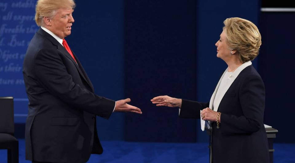 Presidential candidates Hillary Clinton and Donald Trump prepare to shake hands after the second presidential debate at Washington University in St. Louis, Missouri on Sunday.