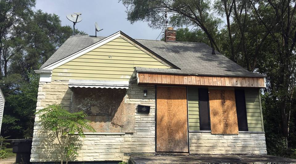 A house that's for sale on a land contract in Detroit. It's common for a house to need a gut rehab.