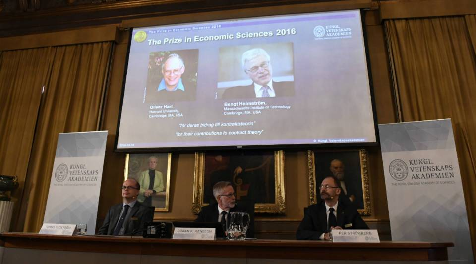 From left to right: Tomas Sjoestroem, member of the Committee for the Prize in Economic Sciences in Memory of Alfred Nobel; Goran K. Hansson, Secretary General of the Royal Swedish Academy of Sciences; and Per Stromberg, Chairman of the Committee for the Prize in Economic Sciences in Memory of Alfred Nobel, attend a press conference at the Royal Swedish Academy of Sciences where they present the laureates for the Nobel prize in economics.