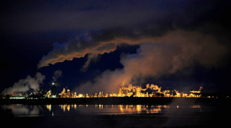 A night view of the Syncrude oil sands extraction facility near the town of Fort McMurray in Alberta, Canada.