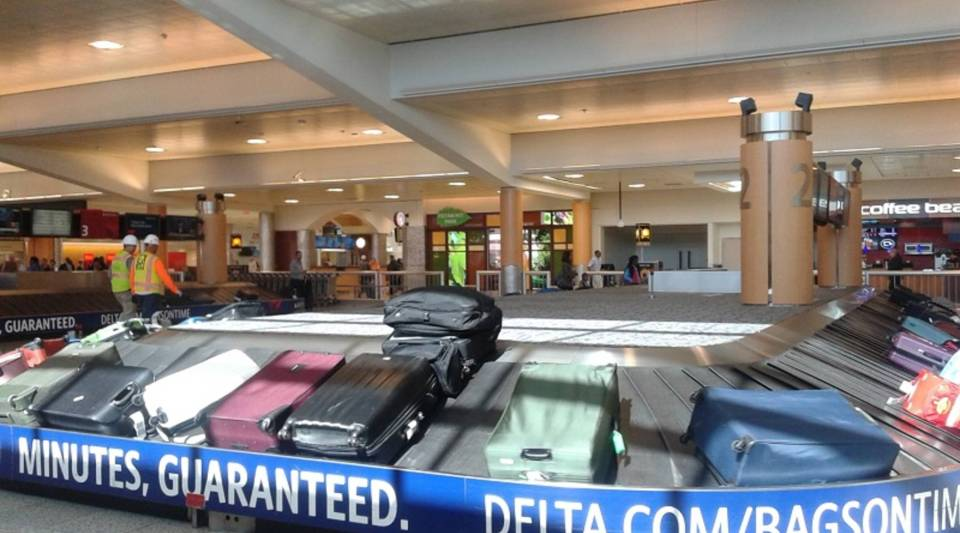 Hartsfield-Jackson Atlanta International Airport is the headquarters for Delta Air Lines. At its baggage claim area, banners say bags are guaranteed to be delivered within 20 minutes.