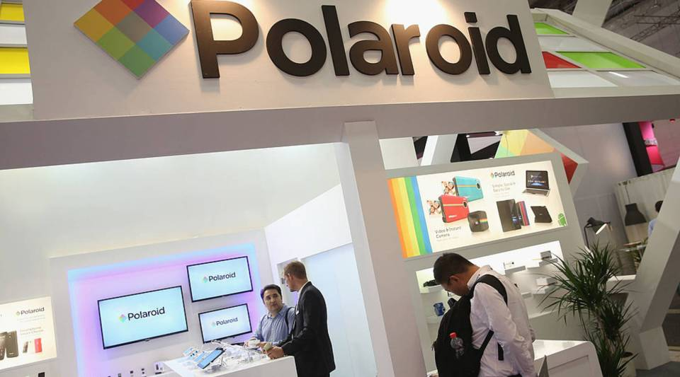 Visitors check out the Polaroid stand at the 2014 IFA home electronics and appliances trade fair on September 5, 2014 in Berlin, Germany.