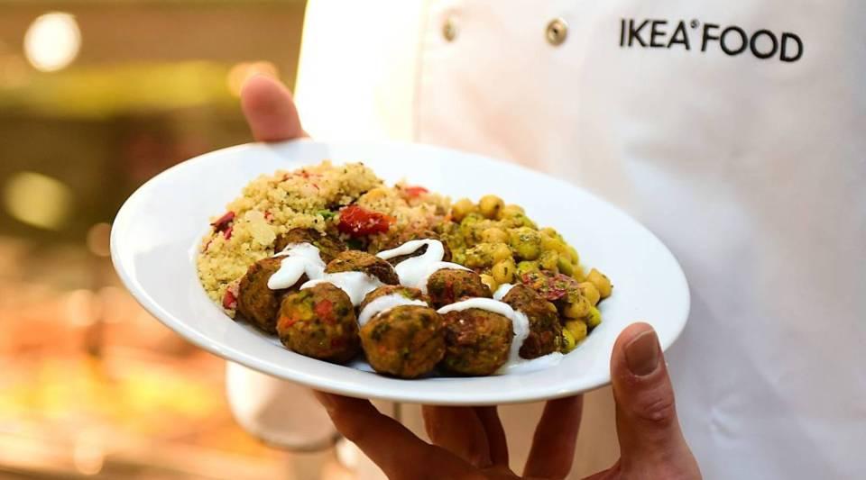 An IKEA employee displays the new IKEA vegetarian meatballs, during a worldwide launch at IKEA Anderlecht, on April 8, 2015.