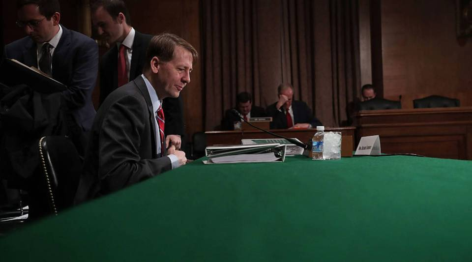 Director of the Consumer Financial Protection Bureau Richard Cordray waits for the beginning of a hearing before the Senate Banking, Housing and Urban Affairs Committee earlier this year on Capitol Hill in Washington, D.C.