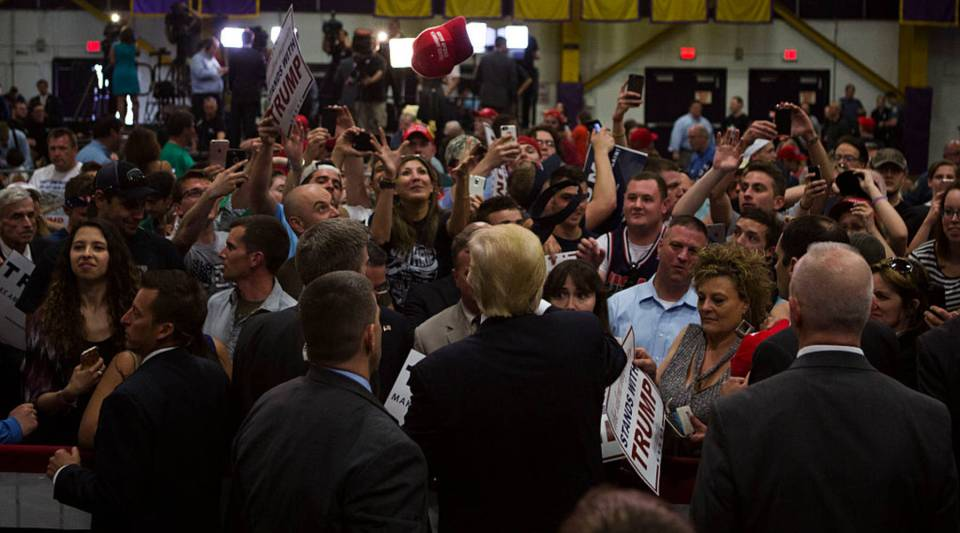 Republican presidential candidate Donald Trump tosses a signed hat back to a supporter at a campaign rally on April 25, 2016 at West Chester University in West Chester, Pennsylvania.