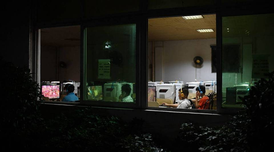 This photo taken on September 14, 2016 shows workers playing online games in the internet cafe at the Huajian shoe factory, where about 100,000 pairs of Ivanka Trump-branded shoes have been made over the years amongst other brands, in Dongguan, in south China's Guangdong province.