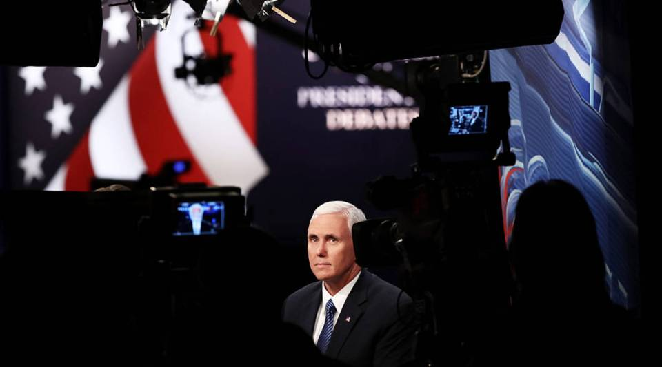 Republican vice presidential nominee Mike Pence speaks with the CNN broadcast crew prior to the start of the third U.S. presidential debate at the Thomas & Mack Center in Las Vegas, Nevada.