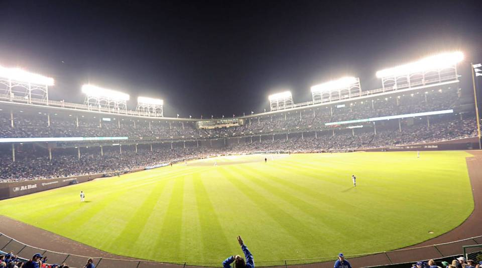 A fan cheers from the bleachers during Game Three of the 2016 World Series between the Chicago Cubs and the Cleveland Indians in Chicago, Illinois.
