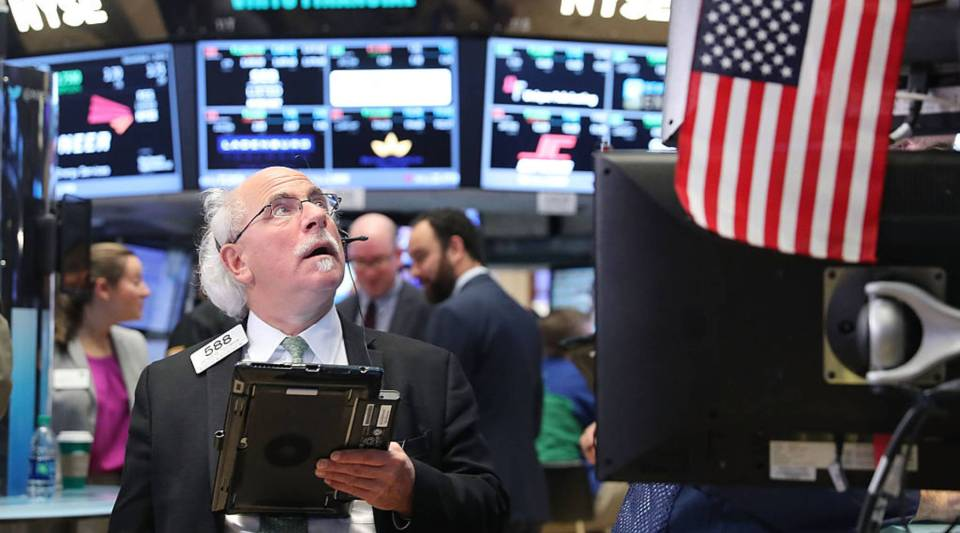 Traders work on the floor of the New York Stock Exchange (NYSE) on November 1, 2016 in New York City. As Wall Street continues to feel election uncertainty, the Dow Jones closes fell more than 100 points.