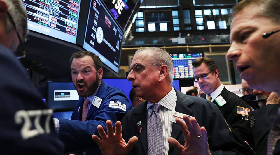 Traders work on the floor of the New York Stock Exchange (NYSE) the morning after Donald Trump won a major upset in the presidential election. Global markets originally dropped after Trump began to pull ahead of his rival Hillary Clinton. In morning trading, The Dow was down slightly.