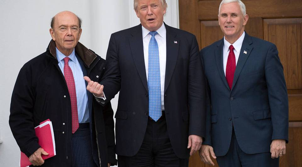 President-elect Donald Trump and Vice President-elect Mike Pence pose for a photo with Wilbur Ross a the clubhouse of Trump National Golf Club November 20, 2016 in Bedminster, New Jersey.