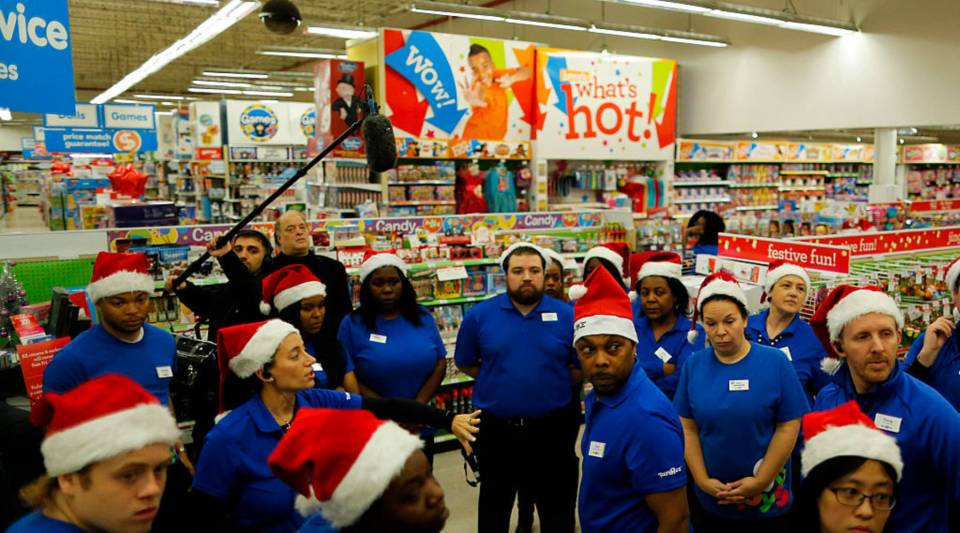 Toys'R'Us workers wait for shoppers inside the store during early Black Friday events on November 24, 2016 in Paramus, New Jersey.