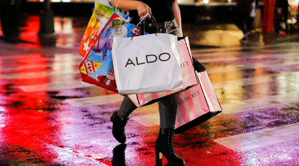 A woman carries retail shopping bags during Black Friday events this year in New York City.