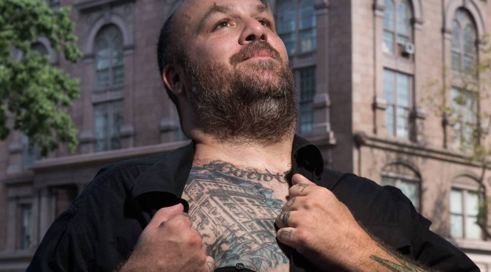 Mike Essl, a graduate and acting dean of the Cooper Union School of Art, bears a tattoo of the college's iconic Foundation Building.