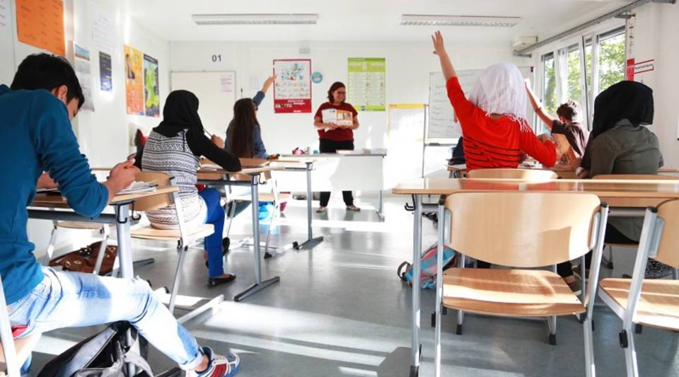 Teacher Susann Heida is in her first month teaching German to teenage refugee students at a Berlin public school. Students in her class come from Syrian, Afghanistan and Iraq.