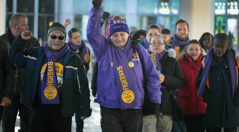 Workers and representatives from the Service Employees International Union leave a press conference at O'Hare Airport on Nov. 21, 2016 in Chicago, Illinois.