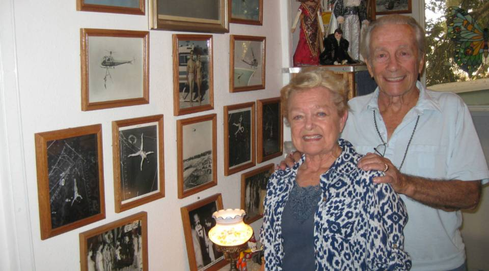 """Ruthie and Frank Clark in their home in Sarasota, Florida, surrounded by photos and memorabilia from four decades performing their aerial act in circuses and exhibitions all over the world. Their stage name was """"Francarro and Estreleta."""""""