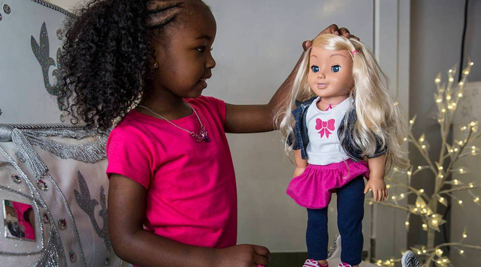 Jayla, aged 4, plays with a 'My Friend Cayla' doll at Hamleys toy shop in London, England. The doll connects to smart devices using Bluetooth and can interact with users.