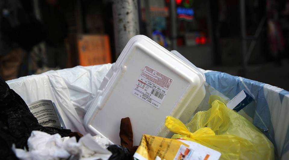 A take out container in a trash bin in New York City.