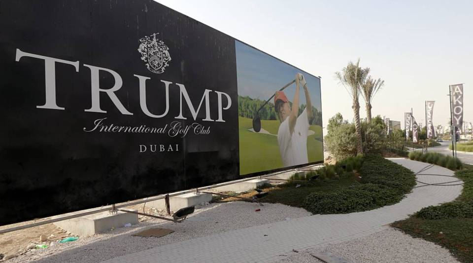 US real-estate magnate Donald Trump is seen playing golf on a billboard at the Trump International Golf Club Dubai in the United Arab Emirates on August 12, 2015.