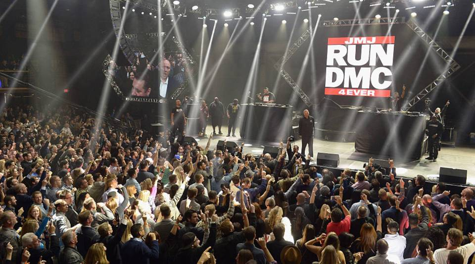 """Recording artists Darryl """"DMC"""" McDaniels (L) and Joseph 'Run' Simmons of Run-D.M.C. perform onstage during DirecTV Super Saturday Night co-hosted by Mark Cuban's AXS TV at Pier 70 on Feb. 6 in San Francisco."""