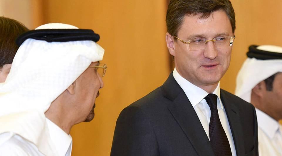Saudi Oil Minister Khalid al-Falih walks alongside his Russian counterpart Alexander Novak during their meeting in Riyadh on October 23, 2016.