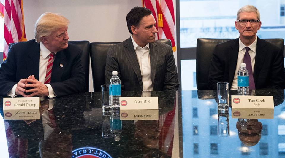 President-elect Donald Trump, Peter Thiel and Tim Cook, chief executive officer of Apple, Inc., listen during a meeting with technology executives at Trump Tower, December 14, 2016 in New York City.