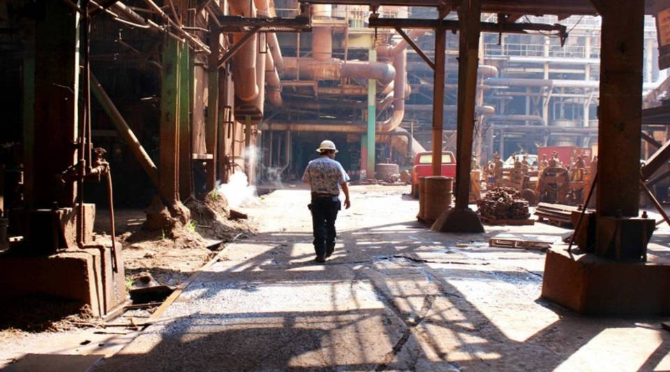 HC&S VP of factory operations Robert Luuwai, walks through the sugar mill on Maui for one of the last times.