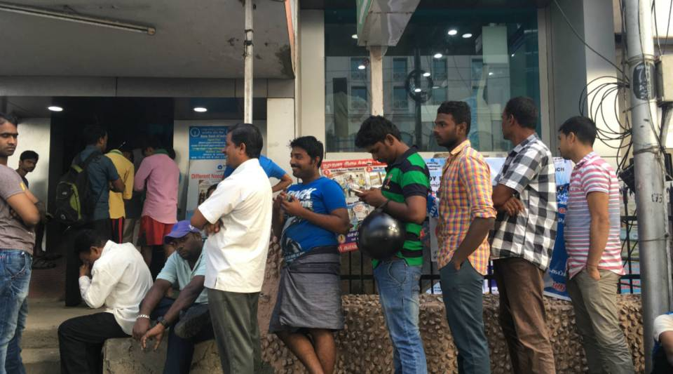 Customers lining up at a bank in India.