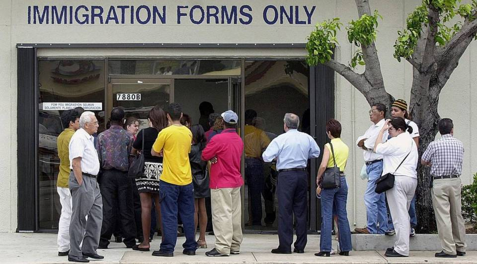 A line forms near the entrance of the Immigration and Naturalization Service office in Miami.