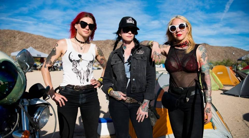 Myra Anderson, left, of Los Angeles; Savannah Rose, of Long Beach; and Candra De Bord, of North Carolina, at the Babes Ride Out campground in Joshua Tree National Park in California.