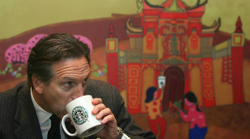 Howard Schultz drinks a cup of coffee at the first Starbucks store in Chongqing, China back in 2006.