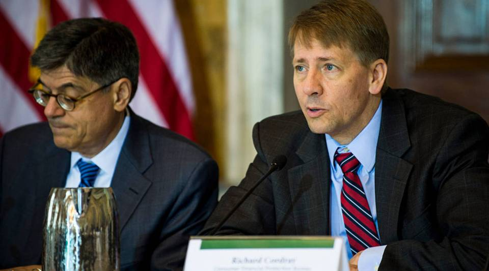 Richard Cordray (R), director of the Consumer Financial Protection Bureau, delivers remarks at a Financial Literacy and Education Commission meeting in D.C.