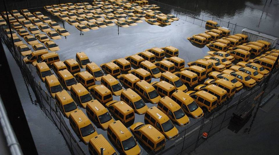 Taxis sit in a flooded lot after Hurricane Sandy October 30, 2012 in Hoboken, New Jersey.