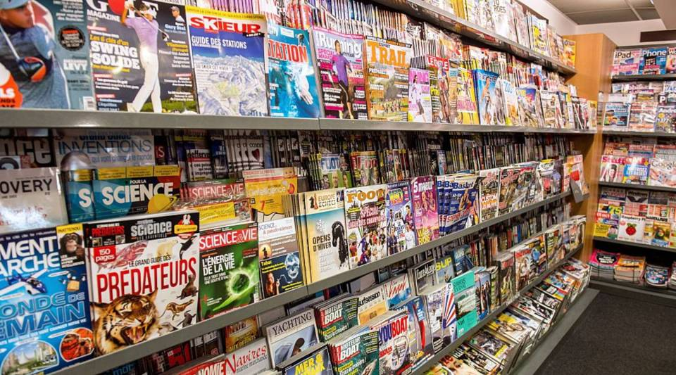 Magazines are on display at a newsstand on February 25, 2015 in Lille.