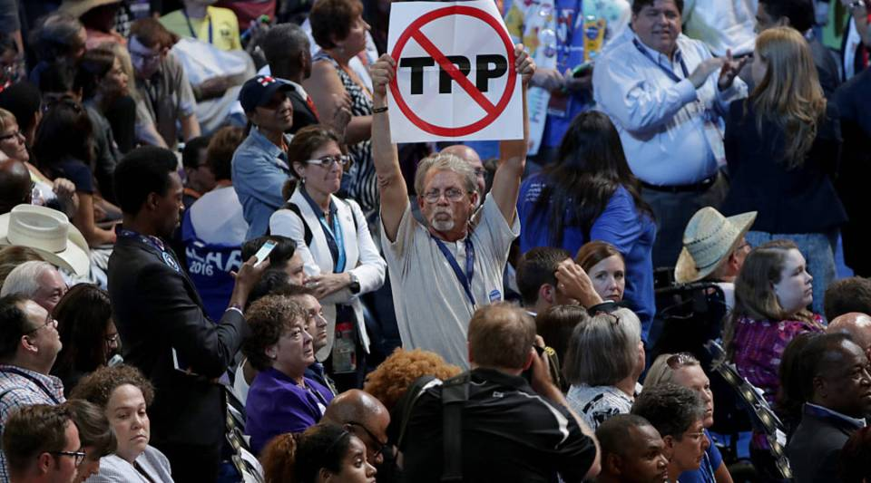 An protestor holds an anti-TPP sign at the Democratic National Convention.