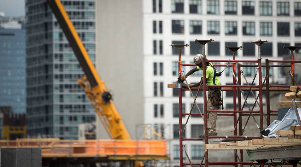 A construction laborer works on the site of a new residential building in the Hudson Yards development, Aug. 16, 2016 in New York City.