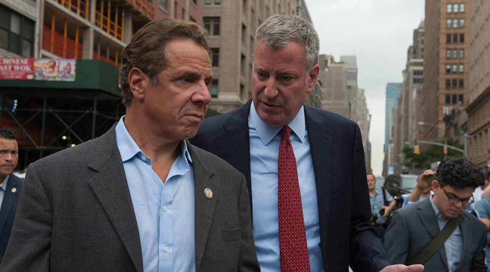 New York Gov. Andrew Cuomo, left, plans to create a defense fund for immigrants, and New York City Mayor Bill de Blasio said he would protect all New York City residents, regardless of immigration status.