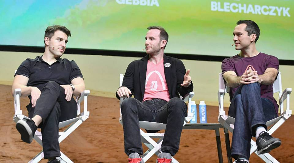 Co-founders of Airbnb Brian Chesky, Joe Gebbia and Nate Blecharczyk speak at a Q&A at the Los Angeles Theatre during Airbnb Open LA on Nov. 19, 2016, in Los Angeles.