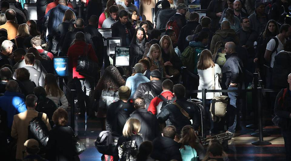 Outbound travelers wait to pass through a TSA security screening area at Reagan National Airport, on December 22, 2016 in Arlington, Virginia.