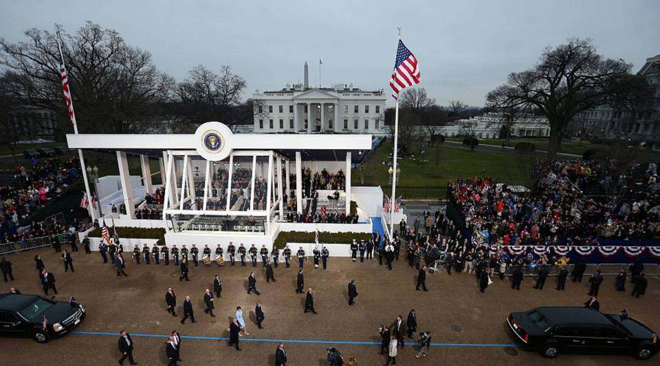 U.S. President Donald Trump waves to supporters as he walks the parade route with first lady Melania Trump and son Barron Trump past the main reviewing stand in front of the White House during the Inaugural Parade on January 20, 2017 in Washington, DC. Donald J. Trump was sworn in today as the 45th president of the United States.