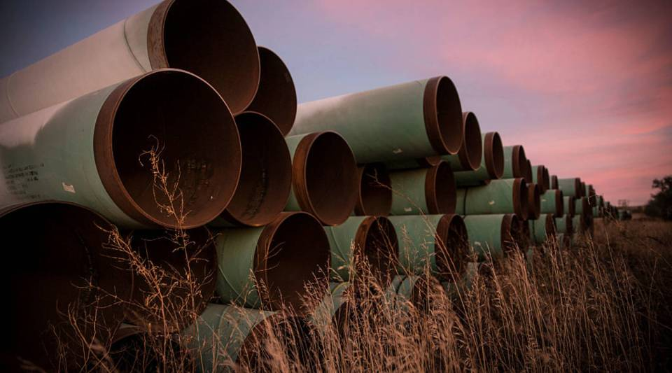 Miles of unused pipe, prepared for the proposed Keystone XL pipeline, sit in a North Dakota lot back in 2014.