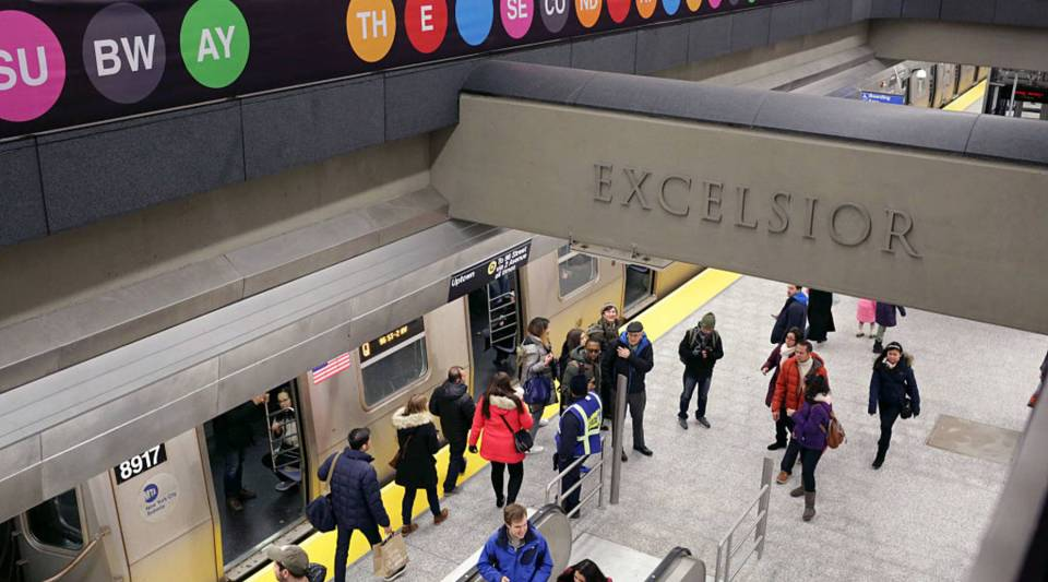 Commuters exit the uptown Q train at the 86th St. station on the newly opened Second Avenue subway line on Sunday in New York City.
