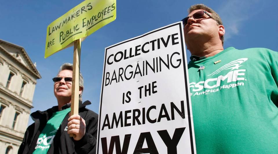 Labor union members protest Michigan Gov. Rick Snyder's proposed budget cuts in April 2011.