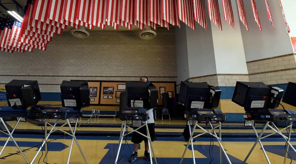 A voter casts a ballot at a voting machine at a polling station at Cheyenne High School on Election Day on November 8, 2016 in North Las Vegas, Nevada.