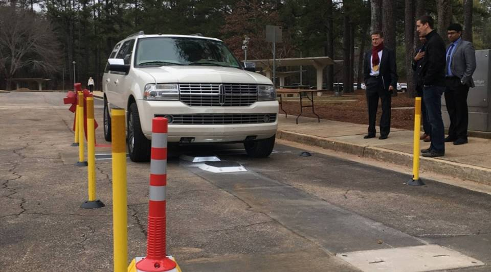 An SUV tests a system that allows drivers to check tire pressure without leaving their vehicle. Built by United Kingdom startup WheelRight, it's part of an effort to transform a stretch of Interstate Highway 85 in Georgia into a testing ground for technology.