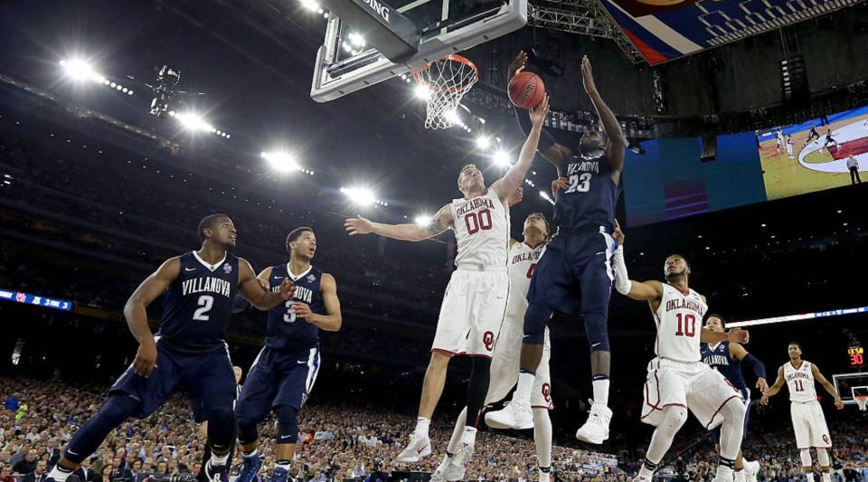 Ryan Spangler, #00 of the Oklahoma Sooners, and Daniel Ochefu, #23 of the Villanova Wildcats, battle for the ball during the 2016 NCAA Men's Final Four Semifinal in Houston.