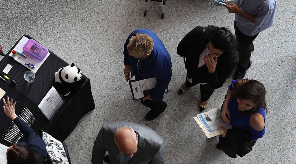 """""""Something like a third of the American population is starting to express pretty grave doubts in their ability to earn their success in the United States,"""" says Arthur Brooks, president of the American Enterprise Institute. Above, people wait in line at a jobs fair in Sunrise, Florida."""