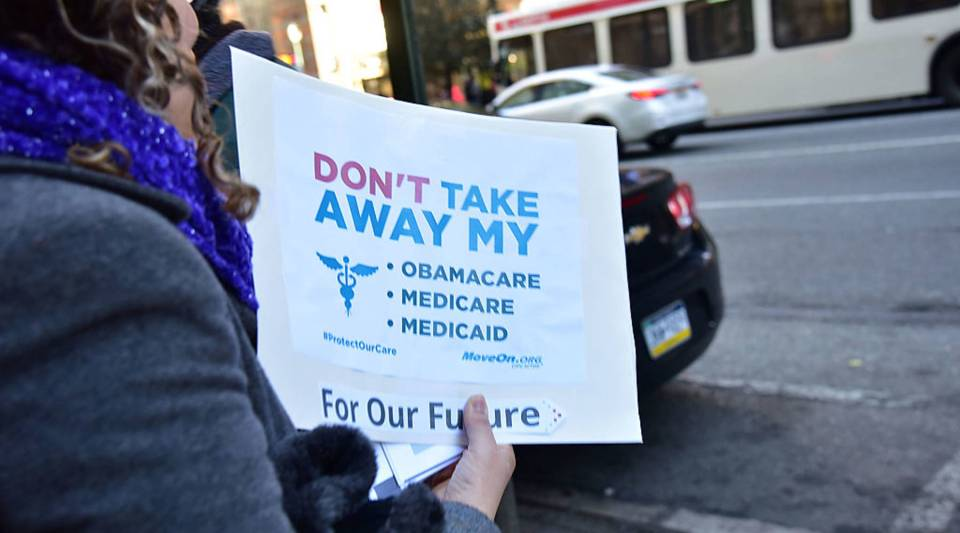 A constituent demonstrates during a rally in support of the Affordable Care Act.